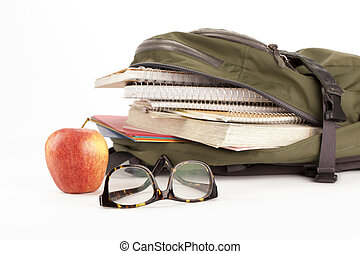 backpack with school supplies and apple on the side