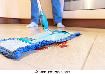 Cropped image of beautiful young woman using a blue mop while cleaning the floor in kitchen