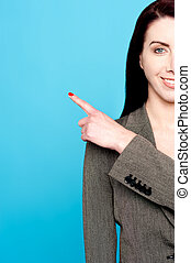 Cropped image of businesswoman pointing