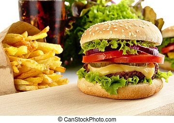 Cropped image of cheeseburger, french fries, glass of cola ...