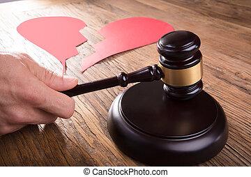 Divorce Judge With Broken Heart At Desk Hitting Gavel