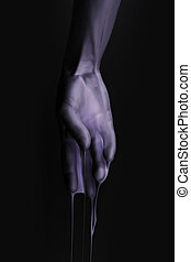 cropped image of female hand in purple paint isolated on black