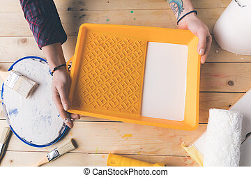 cropped image of girl holding tray with paint