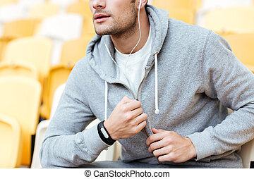 Cropped image of handsome young sports man