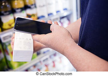 Cropped Image Of Man Scanning Barcode Through Smart Phone