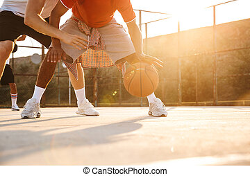 Cropped image of multiethnic men basketball players playing ...