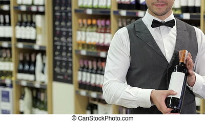 Cropped image of sommelier - Confident sommelier. Cropped...