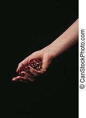 pomegranate in hand