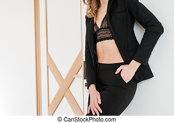 Cropped image of woman posing in apartment