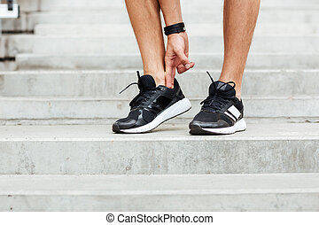Cropped image of young sports man footwear