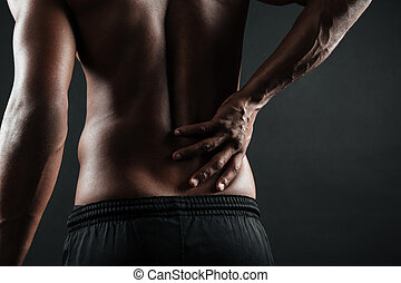 Cropped photo of young afro american man with back pain, ...