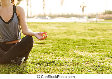 Cropped photo of young fitness woman meditate
