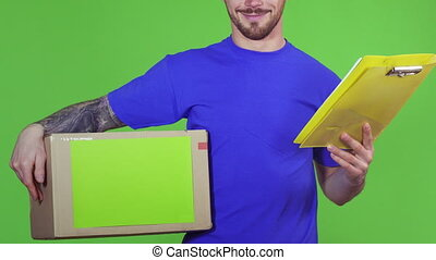 Cropped shot of a deliveryman holding copyspace cardboard...