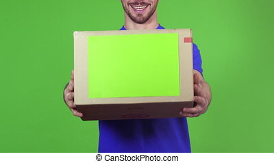 Cropped shot of a deliveryman holding out copyspace cardboard box to the camera