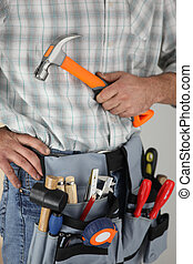 Cropped shot of a handyman with a hammer