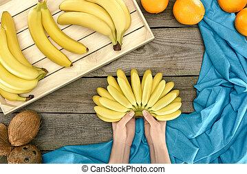 bunch of bananas in hands