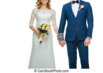 cropped shot of chained wedding couple holding hands isolated on white