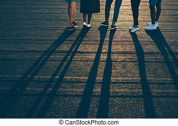 group of people on sunset