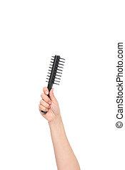 hand holding hairbrush
