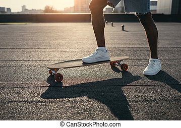 man riding on skateboard on rooftop