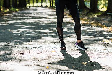 woman in sportswear at autumn park