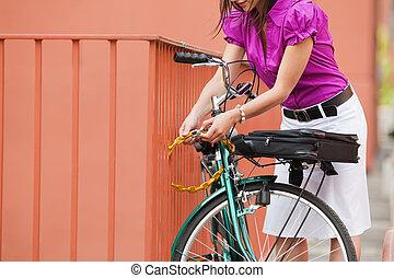woman locking padlock