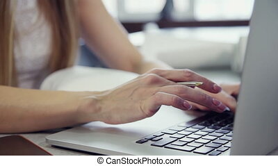 Cropped view of hands typing text on modern laptop - Cropped...