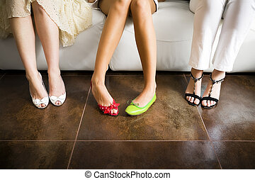 mismatched shoes - Cropped view of woman wearing mismatched ...