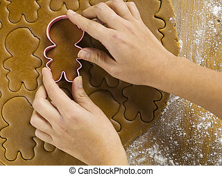 cropped view of womans hand using cookie cutter