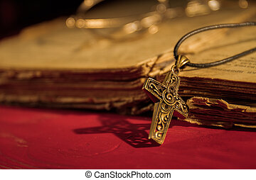 Cropper Christian cross necklace on Holy Bible.