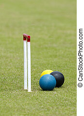 Croquet Game - Croquet balls and playing tools in a club.