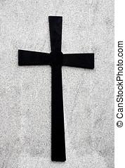 Cross - a black cross isolated against a grey flecked stone...
