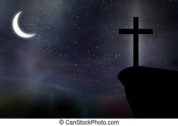 Cross against night sky - Silhouette of Cross against at...