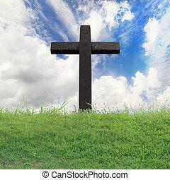 Cross against on blue sky