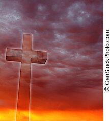 Cross against sunset sky