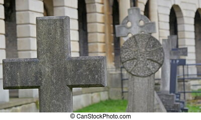 Cross and circle statue on the gravestone