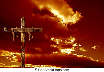 Cross and Clouds - An empty bloody cross against a red...