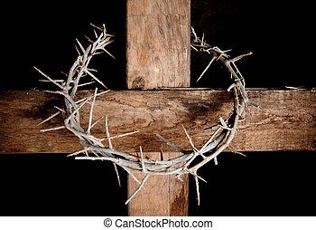 Cross and crown - Crown of thorns hung around the Easter...