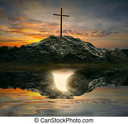 Cross and empty tomb - A single cross with the reflection of...