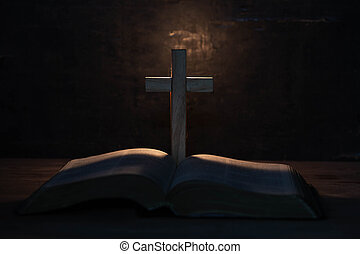 cross and holy Bible on wooden table