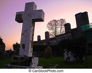 Cross at Sunset - Cross and buildings, taken at sunset at...