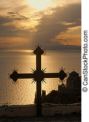 Cross at sunset on Mount Athos, Greece