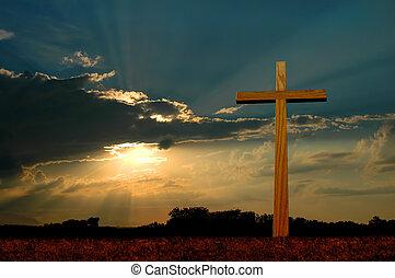 Cross at Sunset - Wooden cross over sunset background.