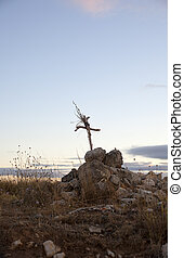 Cross built with branches in a countryside