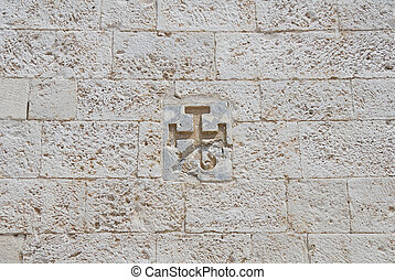 Cross carved in a wall.