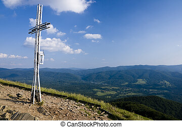 Cross Catholic at the top of the Bieszczady Mountains in Poland