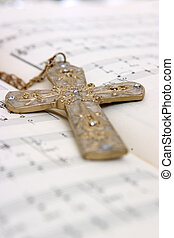 Closeup of a cross on top of notes