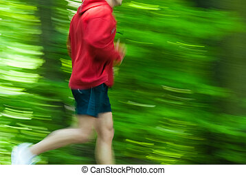 Cross country runnerq - Runner in a fresh green prk wearing...