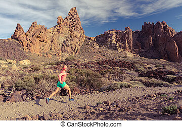 Cross country running in mountains on rocky trail