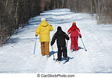Cross Country Ski - family skiing on trail
